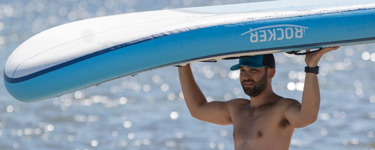 Carrying iROCKER BIG BLUE Paddle Board